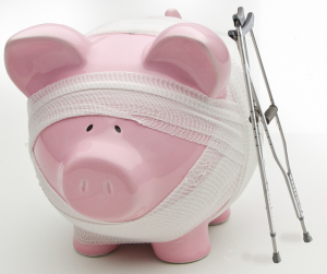 Photo of a piggy bank with crutches and gauze wrapping
