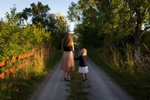 mom and daughter walking