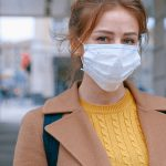 Woman wearing a mask before visiting a doctor.